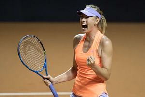 Sharapova celebrates after defeating Ekaterina Makarova.