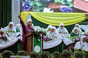Parti Islam SeMalaysia spiritual leader Hashim Jasin speaking at the opening ceremony of the PAS Women's annual congress in Kedah yesterday. The party's outgoing Youth chief Nik Abduh Nik Aziz said that if PAS wins big at the general election, it cou