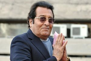 Vinod Khanna gestures while in New Delhi, on March 1, 2013.
