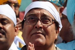 Veteran Bollywood actor Vinod Khanna prays at a Sikh shrine in Amritsar, India, on March 26, 2014.