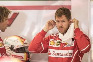 Vettel in the garage during the first practice session in Sochi.