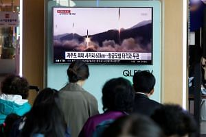 South Koreans watching a new broadcast about North Korea's missile launch at a railway station in Seoul on April 29, 2017.