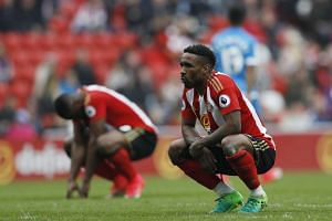 Sunderland's Jermain Defoe and Victor Anichebe look dejected after the match.