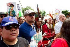 US actor Leonardo DiCaprio (second left)  takes part in the People's Climate March.