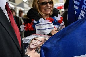 Supporters of Ms Marine Le Pen campaigning for the FN candidate ahead of the May 7 vote in the French presidential election.