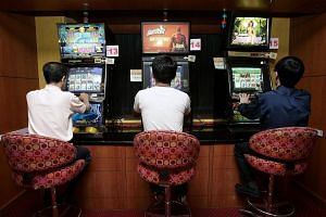 People playing at a jackpot room at Downtown East.
