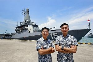 Lt-Col Tay Choong Hern (left), the commanding officer of the LMV Independence, and Lt-Col Chew Chun Chau, head of the LMV project office, with the soon-to-be-commissioned vessel at Changi Naval Base last Friday.