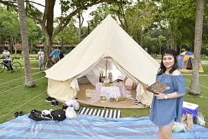 Customers of glamping service provider Noor Azmi Omar (not pictured), who charges $230 a night for a tent that can fit 12 people, giving their glamping package the thumbs up. Six-year-old Goh Jun Yi (second from right) and his mother Lim Fang Qi (beh