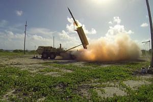 A THAAD interceptor missile is  launched from a battery on Wake Island in the Pacific Ocean,