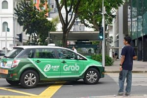 """Some will describe the use of """"ambassadors"""" here by Uber and Grab to woo rival drivers as poaching, but Associate Professor in business law Dennis Ong says this is not so."""