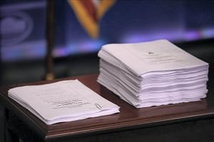 A copy of Obamacare repeal and replace recommendations (left) produced by Republicans in the US House of Representatives sit next to a copy of the Affordable Care Act during a press briefing at the White House in Washington, US on March 7, 2017.