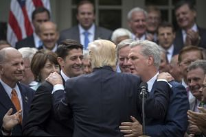 President Donald Trump is embraced by House Republican leaders as they came to the White House to celebrate the passage of the American Health Care Act, in Washington.