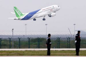 China's home-grown C919 passenger jet takes off from Pudong International Airport on its maiden flight.