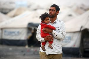 A displaced Syrian, who fled the countryside surrounding the Islamic State in Iraq and Syria's stronghold of Raqqa, at a temporary camp in the village of Ain Issa on Tuesday. Moscow has been touting a plan to create safe zones in Syria aimed at