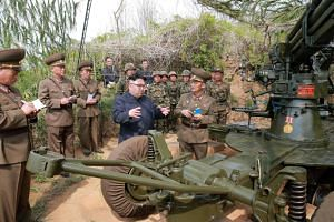 North Korean leader Kim Jong Un inspects the defence detachment on Jangjae Islet on May 5, 2017.