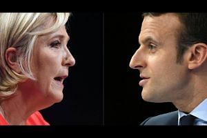 A collage of French far-right Front National (FN) party candidate for the presidential election Marine Le Pen (left) and French presidential election candidate for the En Marche ! movement, Emmanuel Macron (right).