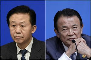 Chinese Finance Minister Xiao Jie (left) and  Japanese Finance Minister Taro Aso will  discuss issues ranging from North Korea's nuclear  programme to the two countries' economic outlook  during the dialogue.