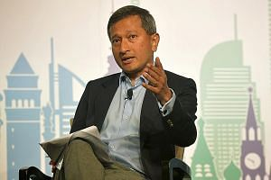 "Dr Vivian Balakrishnan believes the Trump administration ""as a whole remains committed to free trade""."