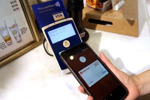 A customer paying with Android Pay, Google's mobile payment and digital wallet service, at a ToastBox outlet.