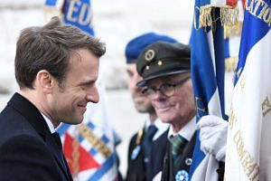 French president-elect Emmanuel Macron greeting veterans during a ceremony marking the 72nd anniversary of Nazi Germany's defeat in World War II. The IMF has hailed Macron's polls win as a boost for open trade. PHOTO: EUROPEAN PRESSPHOTO AGENCY