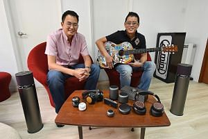 Co-founders of XMI and brothers Reuben (left) and Ryan Lee, who is the chief executive, with some of the company's audio products. Despite financial mismanagement, wireless technology disruption and lost margins due to e-commerce, XMI - after a fund-