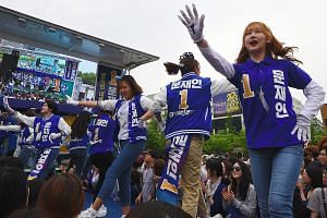 Supporters of South Korean presidential candidate Moon Jae In of the Democratic Party dancing during an election campaign in Goyang city, north-west of Seoul, last Thursday.