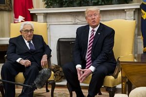 Trump talks about his firing of Comey while meeting with Henry Kissinger in the Oval Office, May 10, 2017.