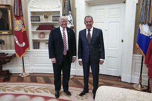 A Russian Foreign Ministry photo shows Trump (left and Lavrov meeting at the White House.