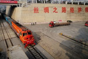 A freight train from Kazakhstan, carrying wheat, arriving at the China-Kazakhstan Lianyungang Logistics Cooperation Base last week. The shipment will be repackaged in China and transported to Vietnam by sea.