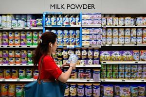 Rows of baby formula powder tins at FairPrice Xtra supermarket.