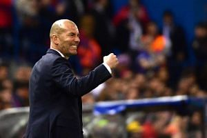 Zinedine Zidane gestures on the sideline during the Uefa Champions League semi-final second leg football match between Atletico Madrid and Real Madrid.
