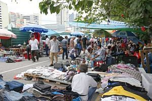 Vendors and shoppers at the Sungei Road flea market, on Feb 25, 2017.