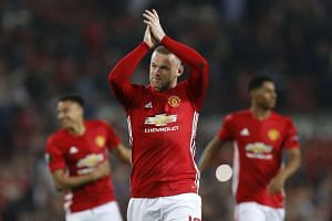 Manchester United's Wayne Rooney applauds fans after the match.