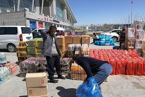 Buyers working for supermarkets in Xinjiang with goods they have just carried out of the China-Kazakhstan cross-border zone. Trade continues to be low-margin in nature, primarily taking advantage of the lack of import taxes for things such as consuma