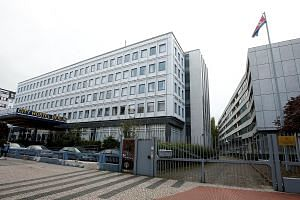 The City Hostel Berlin (left) and the compound of the North Korean embassy in the German capital. The hostel, formerly diplomatic quarters, has been earning Pyongyang tens of thousands of euros a month for the past decade, but it will soon be closed