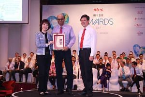 DPM Tharman Shanmugaratnam (centre) receiving the Medal of Honour from Mary Liew (NTUC President) and Mr Chan Chun Sing (NTUC Secretary-General) at the May Day Awards on Saturday, May 13 2017.