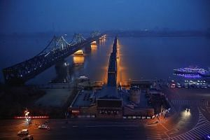 A view of the Friendship and Broken bridges that link Dandong in China to the North Korean border town of Sinuiju across the Yalu River. China has a long record of shielding North Korea from more painful sanctions because it is afraid of a regime col