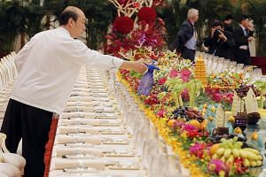 The lavish set-up for the forum's welcome banquet at Beijing's Great Hall of the People included food sculptures of camels and trading ships that plied the Silk Road.