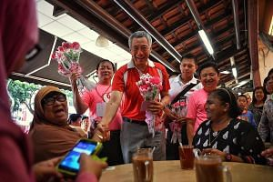 Residents in Hougang Ave 8 got a surprise treat with their morning coffee yesterday - pink carnations from Prime Minister Lee Hsien Loong. Mr Lee and his fellow MPs from Ang Mo Kio GRC and Sengkang West gave out 10,000 flowers in all to mark Mother's