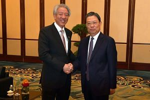 Minister of the Organisation Department of the Communist Party of China (CPC) Central Committee Minister Zhao Leji call on Deputy Prime Minister Teo Chee Hean (left) before the 6th Singapore-China Forum on Leadership at Shangri-La, on May 16, 2017.