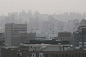 Haze covering buildings and the cityscape in Seoul, South Korea.