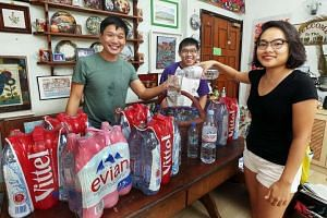 Undergrad Sarah Goh, with her brothers Gabriel and Joshua. The family goes through at least 12 1.5-litre bottles a week.