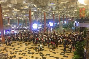 The queue heading to departure hall at Terminal 3.