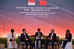Mr Zhao Leji, Communist Party of China (CPC) Politburo member and Central Committee Organisation Department Minister (second from left), and Deputy Prime Minister Teo Chee Hean (second from right).