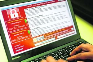 A programer shows a sample of a ransomware cyberattack on a laptop in Taipei.