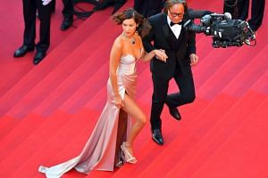 US model Bella Hadid and her father Mohamed Hadid arrive on the red carpet.