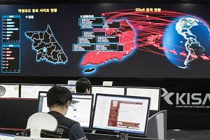 Staff monitoring the spread of ransomware cyber-attacks at the Korea Internet and Security Agency in Seoul on May 15, 2017.