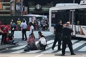 First responders are at the scene as people help injured pedestrians after a vehicle struck pedestrians on a sidewalk in Times Square in New York, US on May 18, 2017.