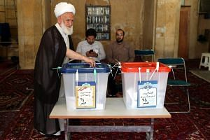Iranians vote for presidential and municipal elections in the holy city of Qom, 130 kms south of Tehran, on May 19, 2017.