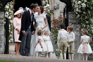 Pippa Middleton and James Matthews kiss after their wedding at St Mark's Church in Englefield, Britain on May 20, 2017.